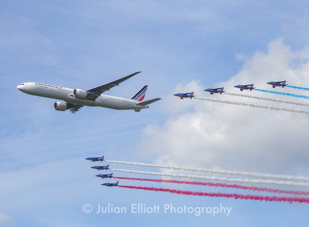 Air France 777 in formation with the jets from the Patrouille de France