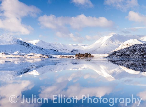 Lochan Na h-Achlaise reflecting the Black Mount.