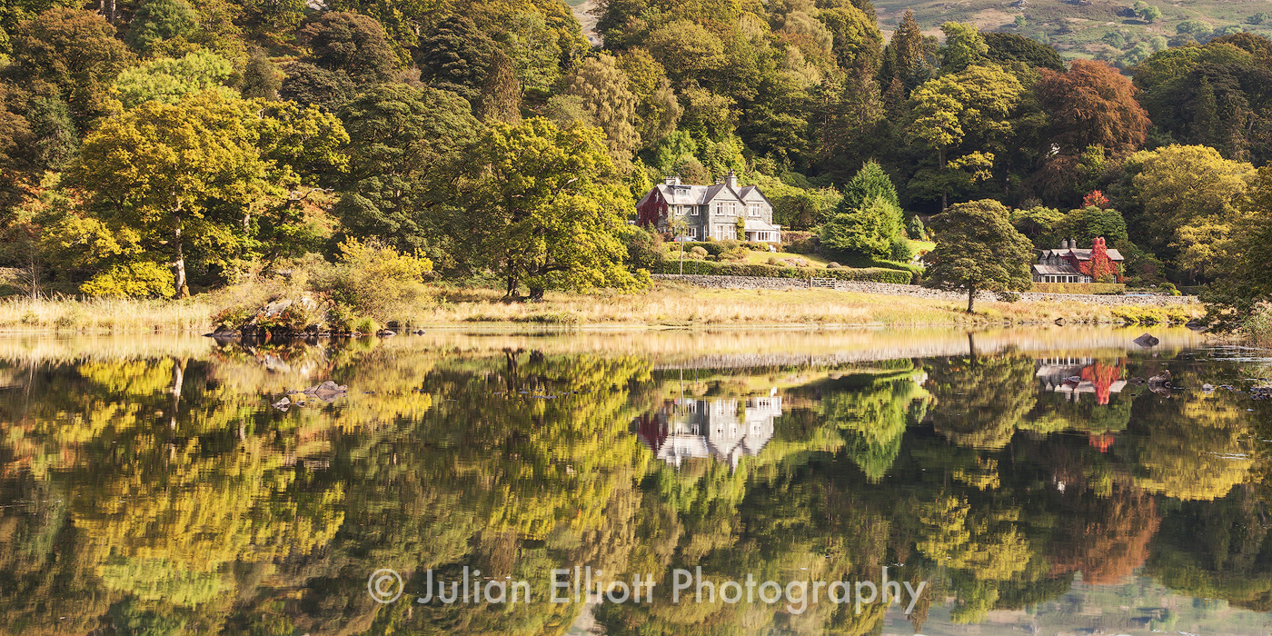 The still water of Rydal Water in the Lake District national park, Cumbria, England.