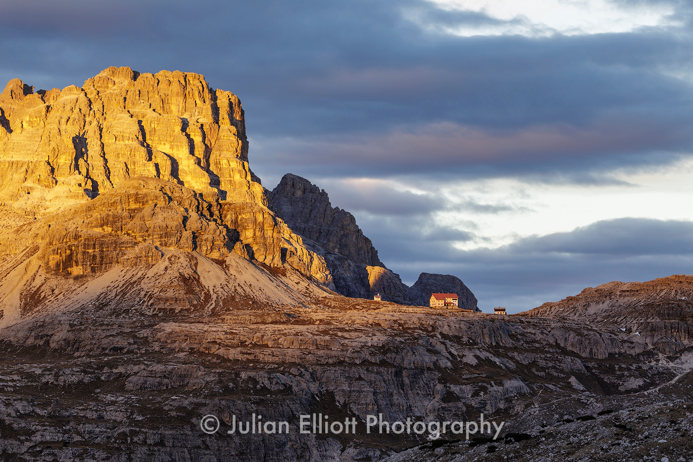 Rifugio Locatelli lit by the setting sun in the Dolomites, Italy.
