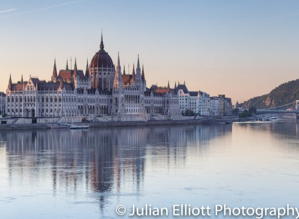 The parliament building in Budapest at dawn.