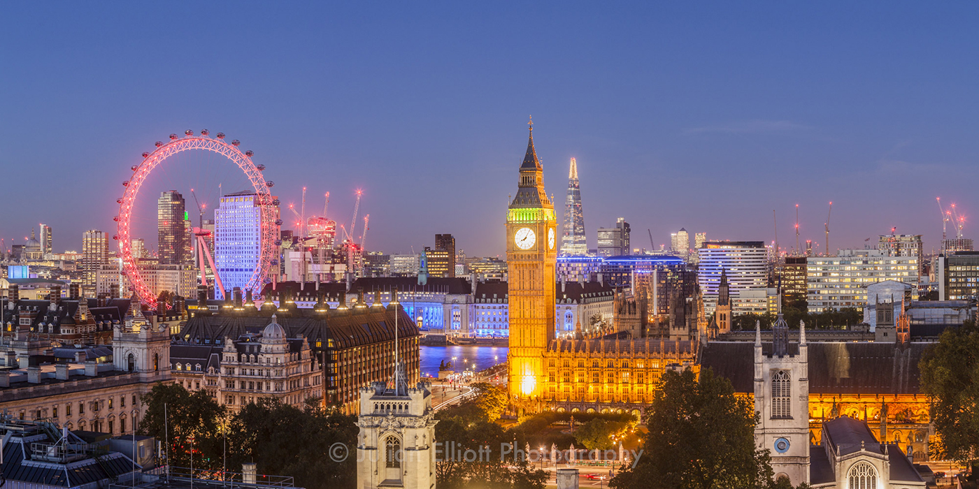 The rooftops of Westminster in London. The view over the rooftops of Westminster showcases the Houses of Parliament; The London Eye and The Shard.