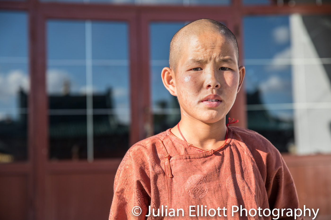 A young buddhist monk in Mongolia.