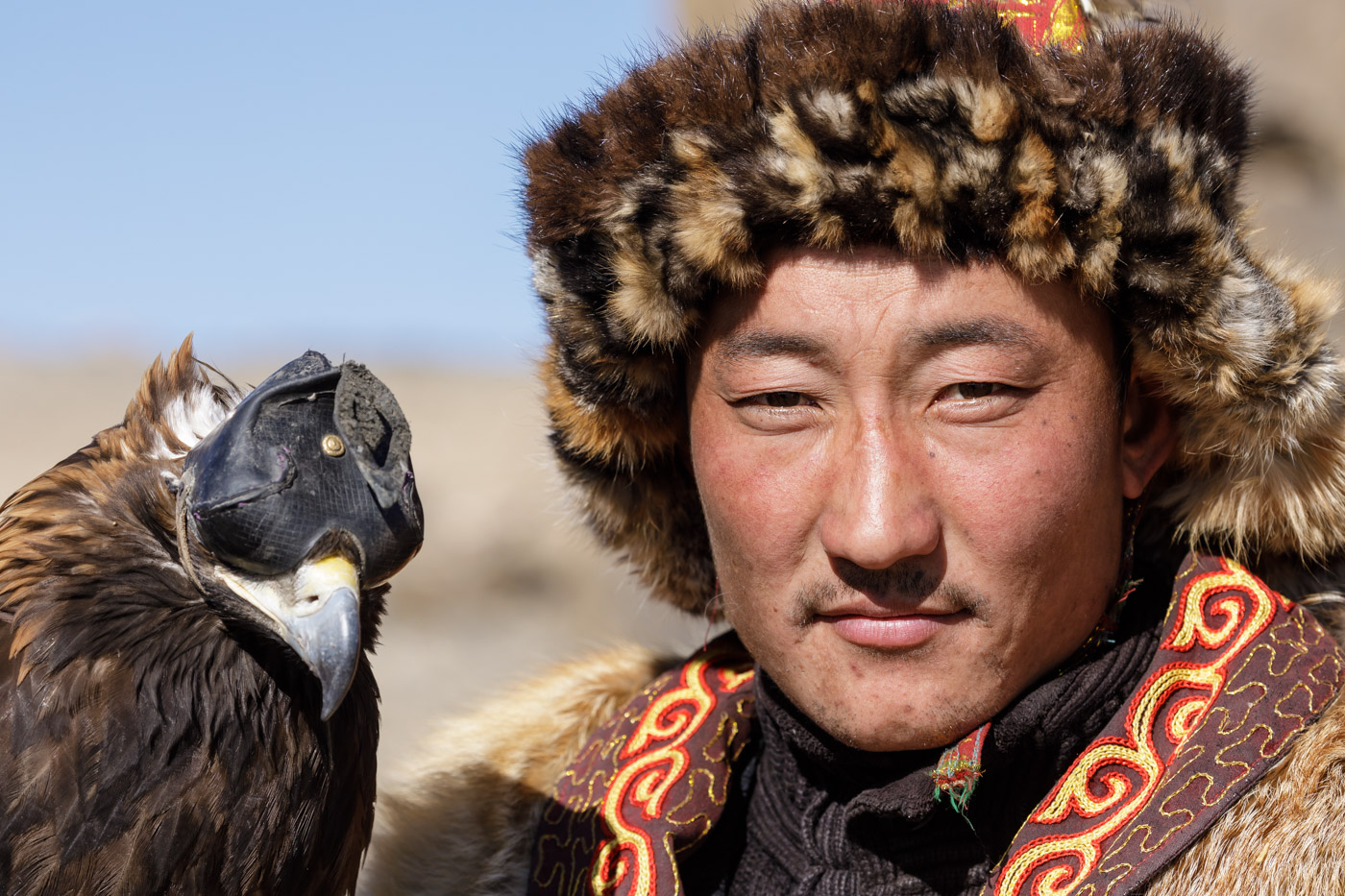 A Kazak Mongolian eagle hunter and his eagle in the Altai