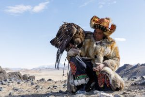 A Kazak Mongolian eagle hunter and his eagle