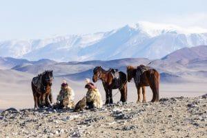 Two Kazak Mongolian eagle hunters