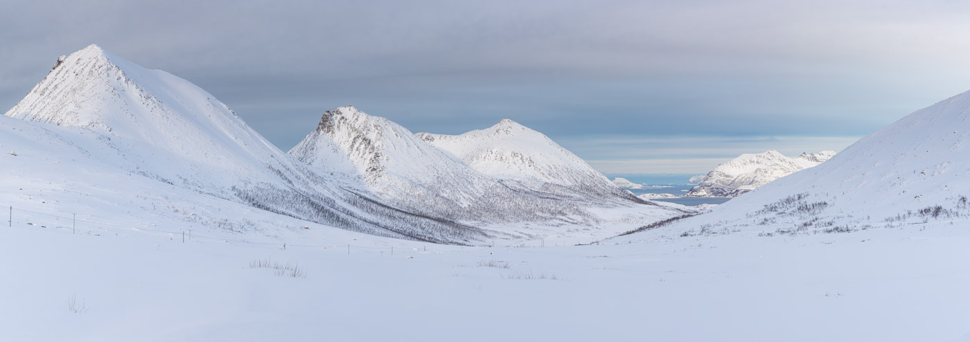 Snow covered mountains near to Kvaloya in northern Norway.